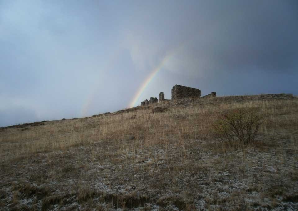 Rainbow over a ruined house in the North-East part of the Yezznaggomer village